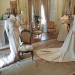 Sample period wedding dresses displayed in the front sitting room