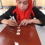 Craftsman designing the silver