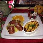 baked polenta w/ agave (delish!), sausage, cheese frittata, & fruit w/ greek yogurt!