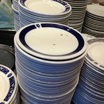 Filthy plates waiting for the guests at breakfast - notice none of the plates are of the same de