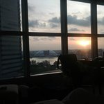 sunrise from 23rd flr room facing suntec city mall/fountain