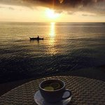 Awesome sunrise over a cup of honey lemon