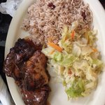 Jerk chicken with cabbage and rice and peas