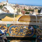 Gaudi mosaic benches with Barcelona skyline in the background