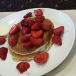 Whole wheat pancakes with fresh strawberries