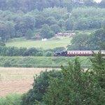 severn valley steam train passing through arley station . the vieuw from worralks grove
