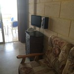 The tv and phone in the room