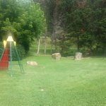 Kids playground, next to pool.