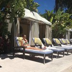 Adult pool chaise and cabanas