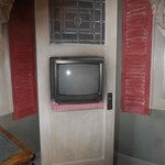 clever placement of the tv in an old door