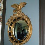 bulls eye mirror in dining room