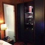 Minibar, wardrobe and bathroom