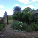 The grounds leading to the walled garden of fruit trees.