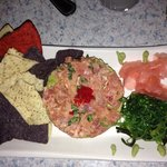 Ahi tuna tartare with avocado.  Skip the chips, eat the seaweed salad.
