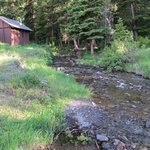 great creek behind cabins, with picnic tables for lunch or dinner too!