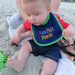 My grandson plays in the sand for the first time