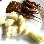 Satay and Nasi lontong rice in banana leaf- $1.10 two doors down from sandat Bali, clean and fre