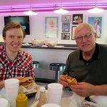 Enjoying Burger and Fries