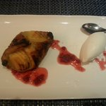 Apple tart with a raspberry jus and homemade coconut ice-cream. Very tasty!