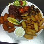 Rump steak, home cooked chips, fresh, crunchy salad and button mushrooms.