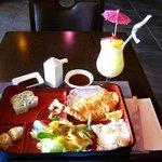 Lunch Bento Box with chicken katsu (fried cutlet) and pina colada beverage