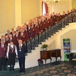 Leigh Orpheus Male Voice Choir on the stairs of The Palace Hotel