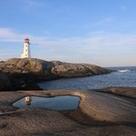 reflections of Peggy's Cove Lighthouse
