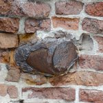 Leftover projectile embedded in wall.