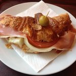 Croissant with ham, cheese and salad