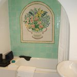 Tiled decoration in bath & shower alcove