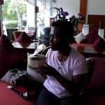 Enjoying coconut milk in Lobby Area.