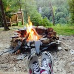 Relaxing at the fire pit.  You can see the wrap-around porch and the gorgeous view in the backgr