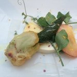 garden Fresh stuffed zucchini flower over fresh mozzarella, jersey peach and local honey drizzle
