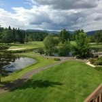 View from the second floor hotel of golf course and peek at outdoor dining