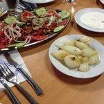 Salad, onions, barbecued onions, yoghurt