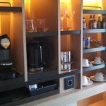 amenities cabinet with nespresso, tea and dishes