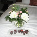 flowers and strawberries and a hand written note of welcome!