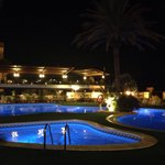 Pool area at night and hotels restaurant 'Ample 32' sunset terrace