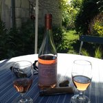 A Bottle of Local Rose in the garden