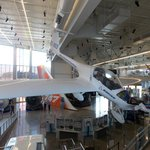 A chase plane is suspended from the ceiling