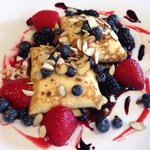 Crepes with lemon cream filling with fresh fruit and slivered almonds
