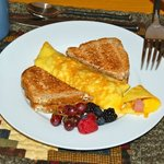 Ham/Bacon omelets, toast with local organic Colorado jams, fresh fruit