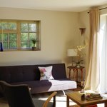 A stylish and comfortable sitting room opens onto a secluded deck.