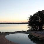 swimming pool overlooking small lake