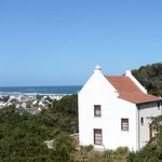 Ship Ahoy Cottage overlooks a small harbour, sea and coastal bush