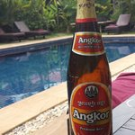Enjoying a local beer at the pool