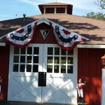 Seabiscuit slept here. Restored stud barn with Howard logo and original weather vane.