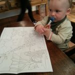 this was my son who was vrry happy with the colouring page he was given upon arrival