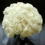 24 Rose Bridal Bouquet Classic White from www.weddingwire.com/MyBouquet