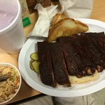 Half rack of ribs with a side of spicy coleslaw